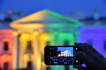A person outside the White House, as equal marriage supporters celebrate