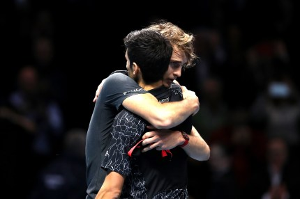 Alexander Zverev of Germany shares a hug with Novak Djokovic of Serbia at the ATP Finals