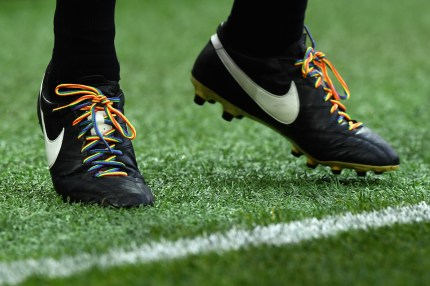 Match official wears rainbow laces to combat homophobic abuse during a Premier League match.