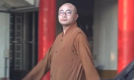 Buddhist monk Kai Hung walks past in full garb
