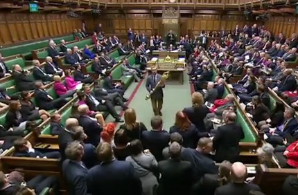 Lloyd Russell-Moyle takes the ceremonial mace from its table and holds it in protest