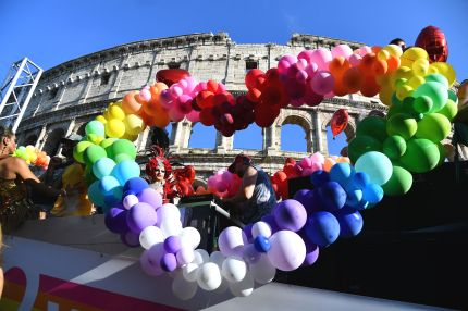 LGBT+ activists, who have condemned the Italian newspaper headline, take part in Gay Pride Parade in Rome on June 9, 2018.