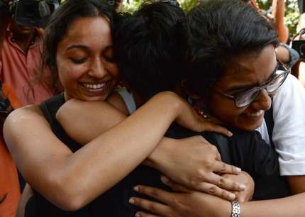 In India, members of the lesbian, gay, bisexual, transgender (LGBT) community celebrate outside the Supreme Court after the decision to strike down the colonial-era ban on gay sex in New Delhi on September 6 2018