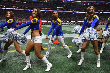 Rams cheerleader Napoleon Jinnies performs with other cheerleaders during Super Bowl LIII between the New England Patriots and the Los Angeles Rams at Mercedes-Benz Stadium in Atlanta, Georgia, on February 3, 2019.