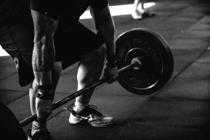 USA Powerlifting: A person lifts weights.