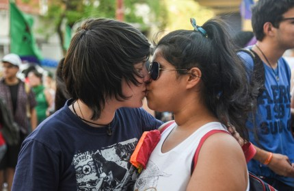 "Gay sex is one of the rights expected by activists such as these people kissing during the 15th LGBTI March with the slogan ""Memory, Pride and Resistance for LGBTI persons rights"" in Asuncion, on September 29, 2018"