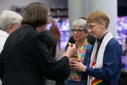 A Methodist bishop receives Holy Communion