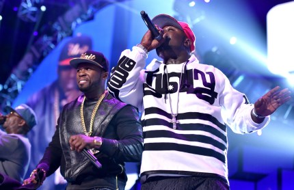 Recording artists Curtis '50 Cent' Jackson (L) and Young Buck of the music group G-Unit perform onstage during the 2014 iHeartRadio Music Festival at the MGM Grand Garden Arena on September 20, 2014 in Las Vegas, Nevada.