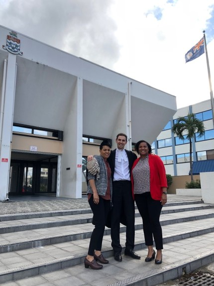Chantelle Day, Peter Laverack, and Vickie Bodden Bush stand outside the court in the Cayman Island that legalised same-sex marriage on March 29.