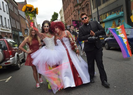 Members of the gay community dressed as brides and a catholic priest make their way along North street as thousands of participants and supporters take part in the 25th annual Belfast Pride parade on August 1, 2015 in Belfast, Northern Ireland. Same-sex marriage whilst legal in the United Kingdom is still not recognised in Northern Ireland despite repeated votes on the issue. The governing Northern Ireland Executive has stated that it does not intend to introduce legislation allowing for same-sex marriage in Northern Ireland.