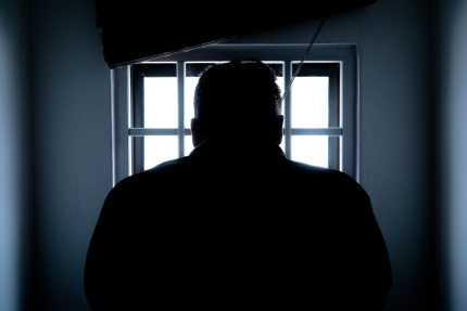 Blacked out man in prison.