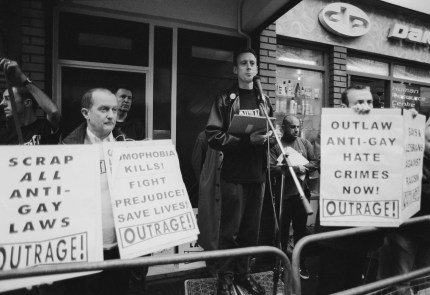 Human rights activist Peter Tatchell (centre) at a vigil organized by the direct action gay rights campaigning group OutRage! in Old Compton Street, Soho, London, 7th May 1999.