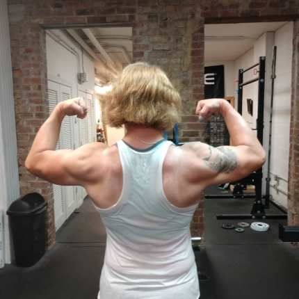 Trans powerlifter Mary Gregory shows her muscles