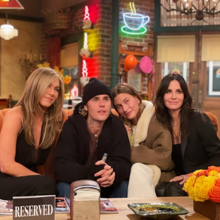 Justin and Hailey Bieber pose with Jennifer Aniston and Courtney Cox on Friends set