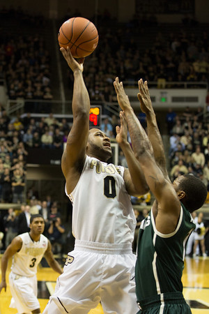 Terone Johnson (0) puts up a shot against Michigan State
