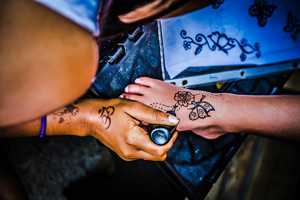 A Henna tattoo is applied on the boardwalk of Ocean City, Maryland