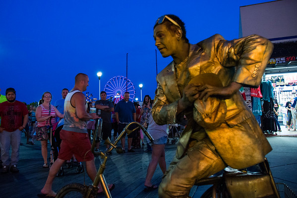 The Golden Man performs on the boardwalk of Ocean City, Maryland on the Atlantic Ocean