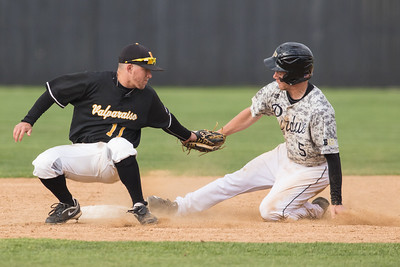 Harry Shipley steals second base whlie Jeff Edwards tries to apply the tag during the baseball game between the Valparaiso Crusaders and the Purdue Boilermakers on May 12, 2015