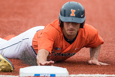 Reid Roper slides back into first base during the Champaign Regional NCAA tournament game between Notre Dame and Illinois on May 31, 2015
