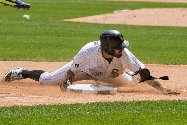 Adam Eaton of the Chicago White Sox hits a triple against the Toronto Blue Jays.