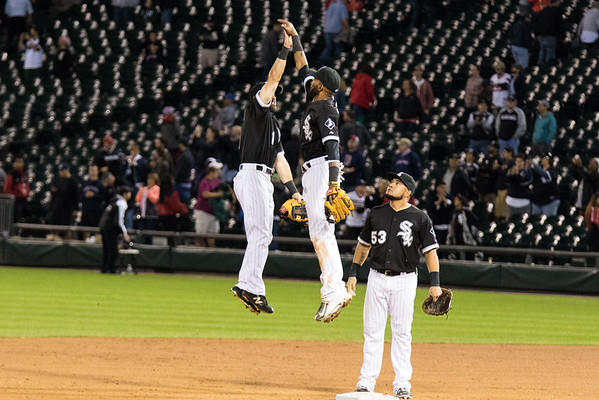 Adam Eaton and Alexei Ramirez celebrate the Chicago White Sox win over the Boston Red Sox on August 25, 2015