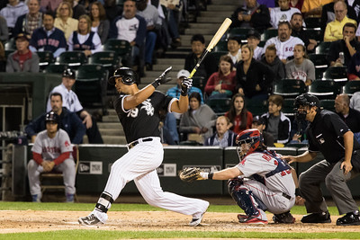 Jose Abreu bats during the Chicago White Sox game against the Boston Red Sox on August 25, 2015