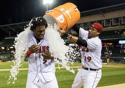 Indianapolis Indians catcher Elias Diaz dumps ice on Josh Bell after Bell won a 13 inning game with a walkoff. It was the first Triple A game of Bell's career.