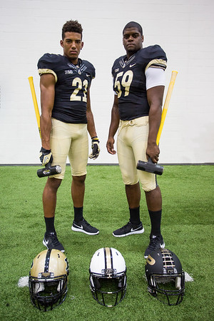 Anthony Mahoungou and Langston Newton pose during the Purdue Football media day on August 9, 2015