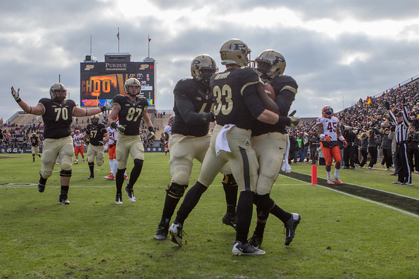 Teammates celebrate with Akkem Hunt (1) after his 62 yard touchdown run in the first quarter