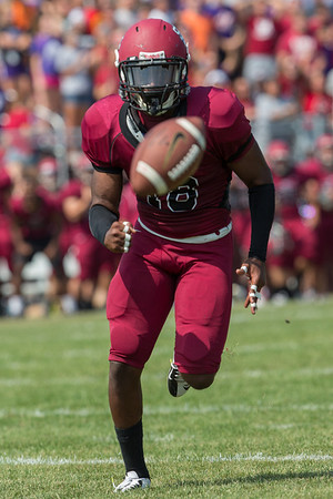 Wilky Orelien (18) chases down the blocked punt during the college football game on September 7th, 2013 at Alumni Stadium. the St. Joseph's Puma's won 34-31 over the Valparaiso Crusaders