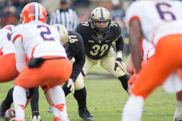 Joe Gilliam (39) looks in on Illinois quarterback Nathan Schellhaase (2)