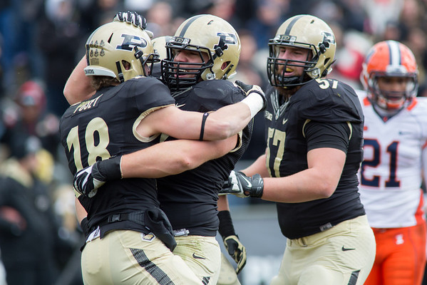 Cameron Posey is congratulated by teammates after scoring a touchdown in the first quarter against Illinois.