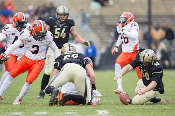 Jesse Schmitt (50) recovers a Illini fumble for Purdue as Patrick Bade (89) makes the tackle