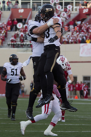 Robert Kuglar (57) and Danny Anthrop (33) celebrate Anthrops 2nd quarter touchdown during the Old Oaken Bucket game between the Purdue Boilermakers and the Indiana Hoosiers
