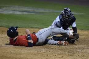 Eduardo de Oleo holds on to the ball as O'Keefe is called out at the plate (Robert M Pimpsner.