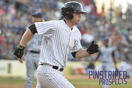 Ryan Krill runs down to first base (Robert M. Pimpsner)