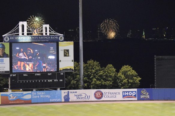 The annual Bayonne, NJ and Jersey City Fireworks shows beyond the left-center field fence. (Robert M Pimpsner)