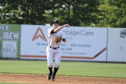 Kyle Holder throws the ball to first to make the first out of the fourth inning (Robert M Pimpsner)
