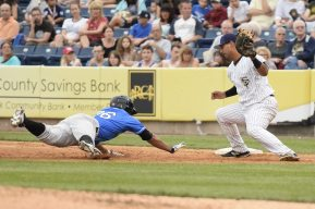 An attempted pick-off play in the top of the fourth inning (Robert M Pimpsner)