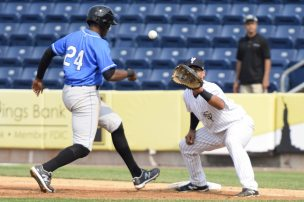 A pickoff attempt by Luis Cedeno to Jake Hernandez in the second inning (Robert M Pimpsner)