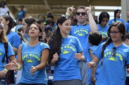 Camp counselors dancing in between innings (Robert M Pimpsner)