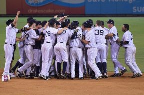 The Staten Island Yankees celebrate on the field (Robert M Pimpsner)