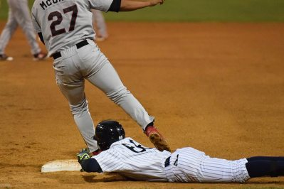 Thairo Estrada just barely gets back to first base in time (Robert M Pimpsner)