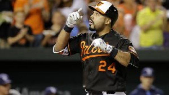 Baltimore Orioles' Pedro Alvarez gestures after hitting a solo home run in the second inning of a baseball game against the Tampa Bay Rays in Baltimore, Friday, Sept. 16, 2016. (AP Photo/Patrick Semansky)