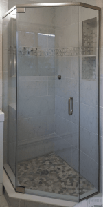 Semi frameless neo-angle shower incorporating pivot hinges on the door