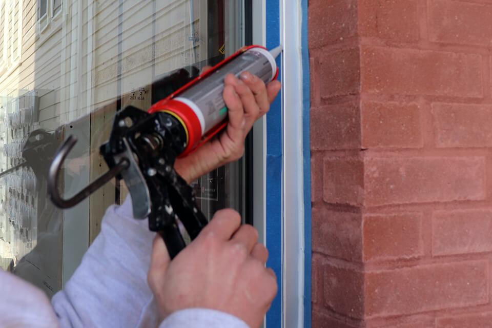 Closeup of Caulking of Commercial Door Glass