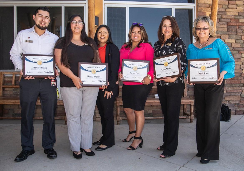 Team Pioneer Members with their Universal Banker certificates