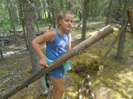 Alberta Camp Cherith Girls Carrying a Large Piece of Wood in Forest