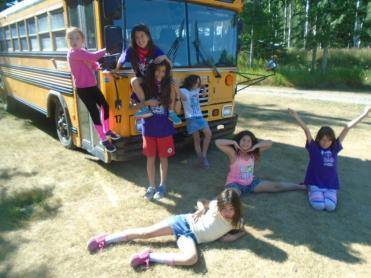Alberta Camp Cherith Girls by School Bus Posing