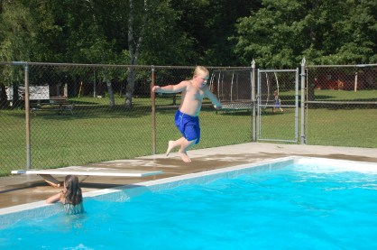 Ontario Camp Cherith boy jumping into pool